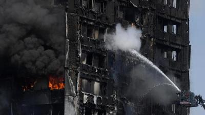 "alt=""Police say 58 presumed dead, missing in London Tower fire"""