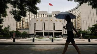 "alt=""China central bank told by Xi to play bigger role in managing financial risk"""