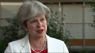 "alt=""Theresa May insists she is 'here for the long term'"""