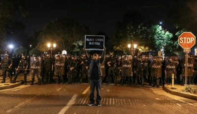 "alt=""Police, protesters clash in St. Louis after ex-cop acquitted of murdering black man"""