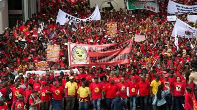 "alt=""Protests grip South Africa as introduction of 'poverty wage' is delayed"""