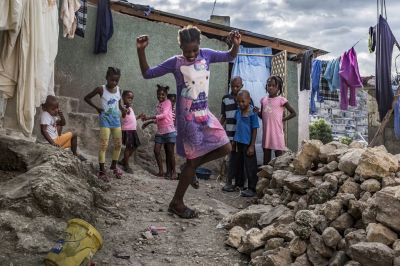 "alt=""Eking out a living in Haiti's colourful slum city"""