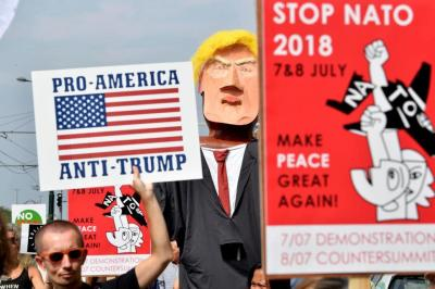 "alt=""European Peace Activists March Against Trump's NATO Visit"""