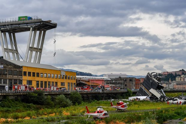 "alt=""Behind Genoa bridge collapse: At least 39 dead as rescuers scramble to find survivors"""