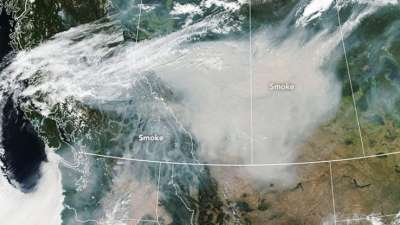 "alt=""Smoke from raging B.C. fires seen from space by NASA satellite"""