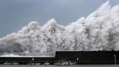 "alt=""Deadly typhoon hits western Japan, flooding major airport"""