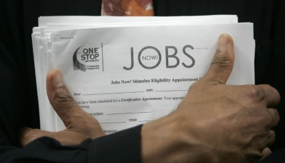 "alt=""U.S. weekly jobless claims drop to near 49-year low"""