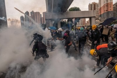 "alt=""Clashes and Tear Gas as Hong Kong Police Confront Protesters in Yuen Long"""
